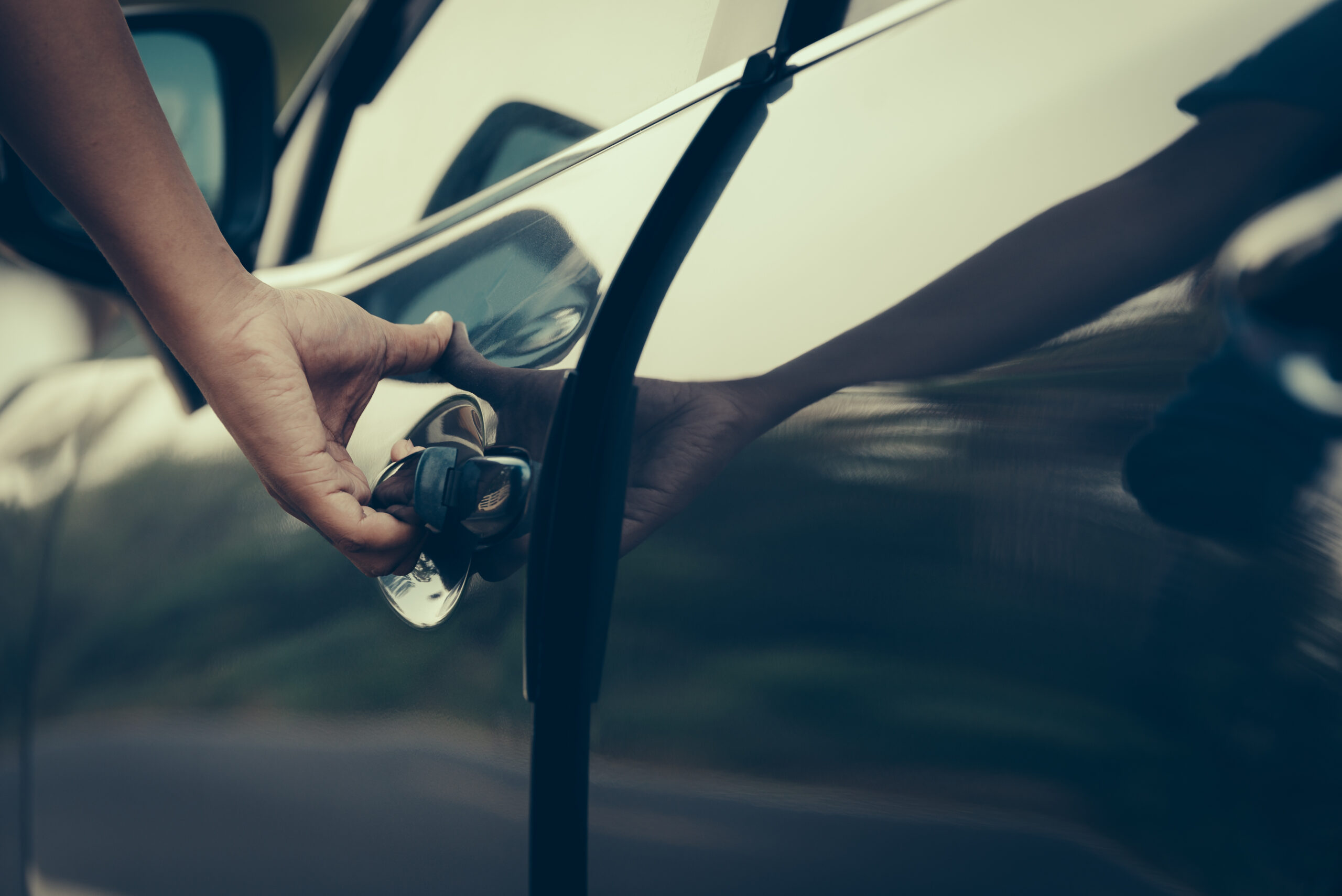 Hand,On,Handle.,Close-up,Of,Man,Hand,Opening,A,Car